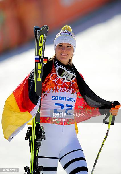 Silver medalist Maria HoeflRiesch of Germany celebrates during the flower ceremony for the Alpine Skiing Women's SuperG on day 8 of the Sochi 2014...
