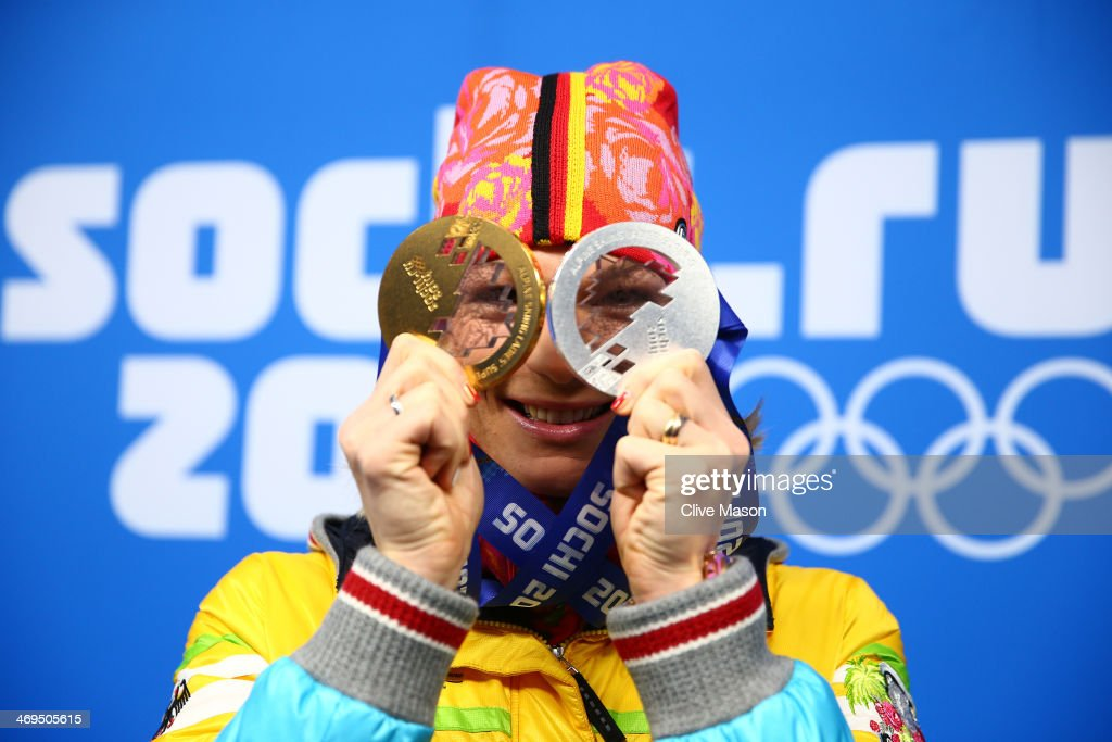 Silver medalist <a gi-track='captionPersonalityLinkClicked' href=/galleries/search?phrase=Maria+Hoefl-Riesch&family=editorial&specificpeople=7648886 ng-click='$event.stopPropagation()'>Maria Hoefl-Riesch</a> of Germany celebrates during the medal ceremony for the Women's Skelton on day 8 of the Sochi 2014 Winter Olympics at Medals Plaza on February 15, 2014 in Sochi, Russia.