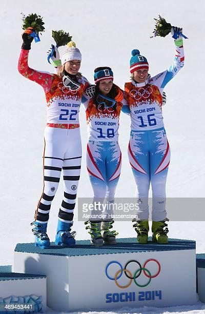 Silver medalist Maria HoeflRiesch of Germany gold medalist Anna Fenninger of Austria and bronze medalist Nicole Hosp of Austria celebrate on the...
