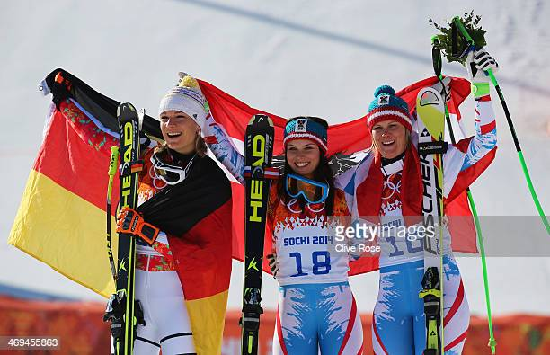 Silver medalist Maria HoeflRiesch of Germany gold medalist Anna Fenninger of Austria and bronze medalist Nicole Hosp of Austria celebrate during the...