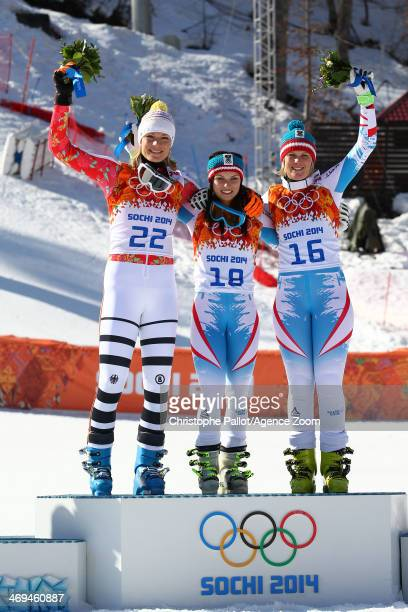 Silver medalist Maria HoeflRiesch of Germany gold medalist Anna Fenninger of Austria and bronze medalist Nicole Hosp of Austria celebrate on the...