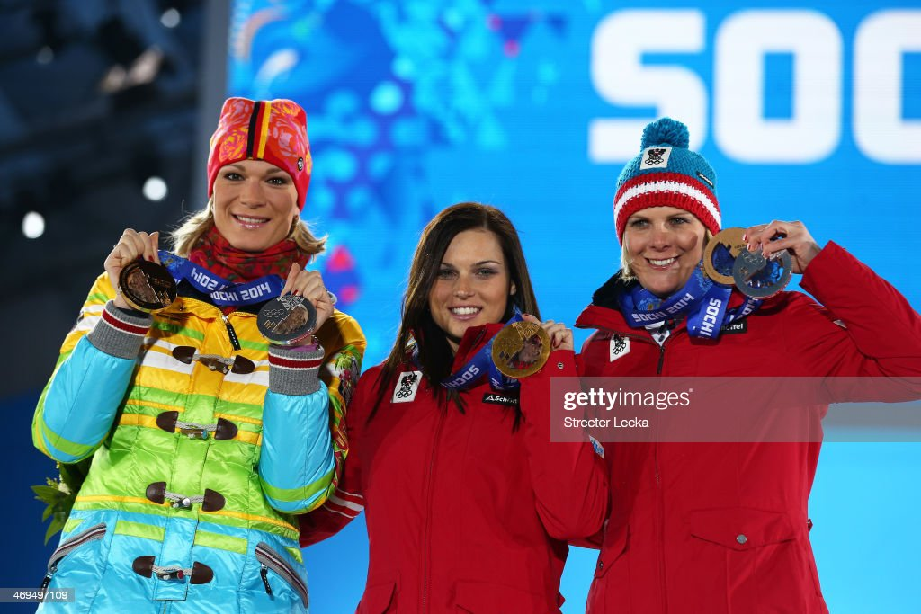 Silver medalist <a gi-track='captionPersonalityLinkClicked' href=/galleries/search?phrase=Maria+Hoefl-Riesch&family=editorial&specificpeople=7648886 ng-click='$event.stopPropagation()'>Maria Hoefl-Riesch</a> of Germany, gold medalist <a gi-track='captionPersonalityLinkClicked' href=/galleries/search?phrase=Anna+Fenninger&family=editorial&specificpeople=4045781 ng-click='$event.stopPropagation()'>Anna Fenninger</a> of Austria and bronze medalist <a gi-track='captionPersonalityLinkClicked' href=/galleries/search?phrase=Nicole+Hosp&family=editorial&specificpeople=226750 ng-click='$event.stopPropagation()'>Nicole Hosp</a> of Austria on the podium during the medal ceremony for the Alpine Skiing Ladiesf Super-G on day 8 of the Sochi 2014 Winter Olympics at Medals Plaza on February 15, 2014 in Sochi, Russia.