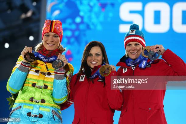 Silver medalist Maria HoeflRiesch of Germany gold medalist Anna Fenninger of Austria and bronze medalist Nicole Hosp of Austria on the podium during...