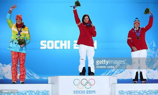 Silver medalist Maria HoeflRiesch of Germany gold medalist Anna Fenninger of Austria and bronze medalist Nicole Hosp of Austria on the podium during...