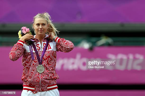 Silver medalist Maria Sharapova of Russia poses on the podium during the medal ceremony after the gold medal match of the Women's Singles Tennis on...