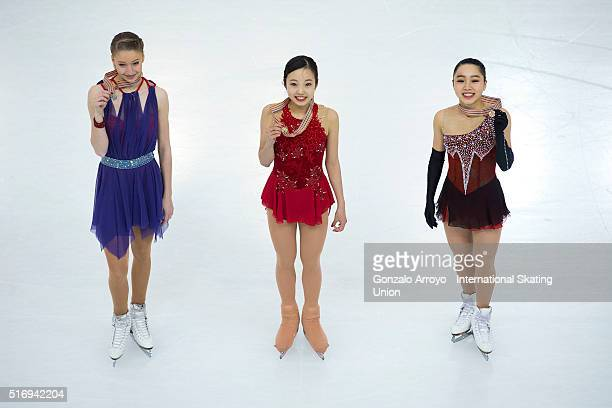 Silver medalist Maria Sotskova from Russia gold medalist Marin Honda from Japan and bronce medalist Wakaba Higuchi from Japan pose for a pciture...