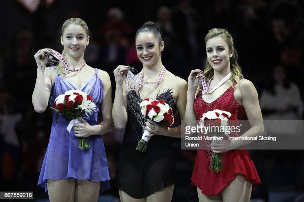 Silver medalist Maria Sotskova of Russia gold medalist Kaetlyn Osmond of Canada and bronze medalist Ashley Wagner of USA during the ISU Grand Prix of...