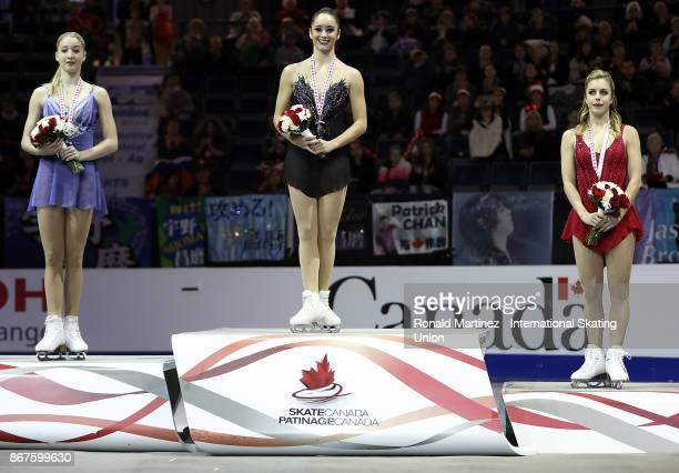 Silver medalist Maria Sotskova of Russia gold medalist Kaetlyn Osmond of Canada and bronze medalist Ashley Wagner of USA in the victory ceremony for...