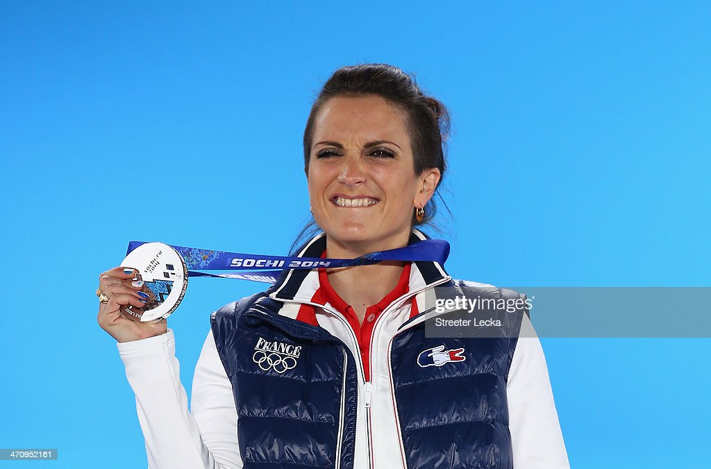 Silver medalist <a gi-track='captionPersonalityLinkClicked' href=/galleries/search?phrase=Marie+Martinod&family=editorial&specificpeople=3071697 ng-click='$event.stopPropagation()'>Marie Martinod</a> of France celebrates during the medal ceremony for the Women's Ski Halfpipe on day fourteen of the Sochi 2014 Winter Olympics at Medals Plaza on February 21, 2014 in Sochi, Russia.