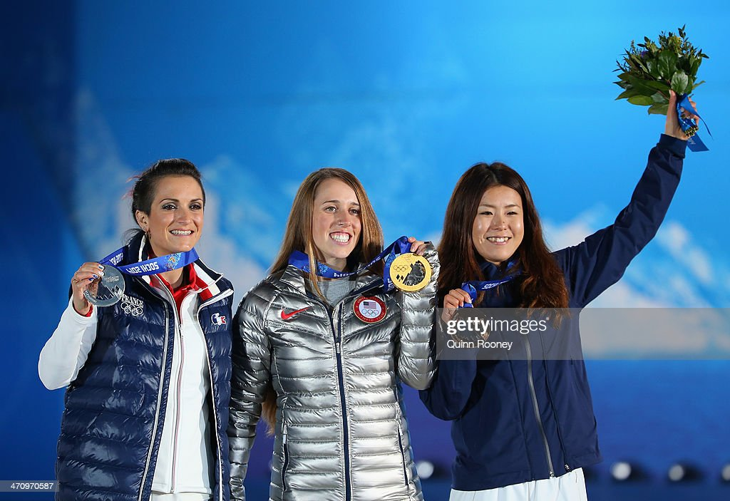 Silver medalist <a gi-track='captionPersonalityLinkClicked' href=/galleries/search?phrase=Marie+Martinod&family=editorial&specificpeople=3071697 ng-click='$event.stopPropagation()'>Marie Martinod</a> of France, gold medalist <a gi-track='captionPersonalityLinkClicked' href=/galleries/search?phrase=Maddie+Bowman&family=editorial&specificpeople=8052656 ng-click='$event.stopPropagation()'>Maddie Bowman</a> of the United States and bronze medalist <a gi-track='captionPersonalityLinkClicked' href=/galleries/search?phrase=Ayana+Onozuka&family=editorial&specificpeople=9028067 ng-click='$event.stopPropagation()'>Ayana Onozuka</a> of Japan celebrate during the medal ceremony for the Women's Ski Halfpipe on day fourteen of the Sochi 2014 Winter Olympics at Medals Plaza on February 21, 2014 in Sochi, Russia.