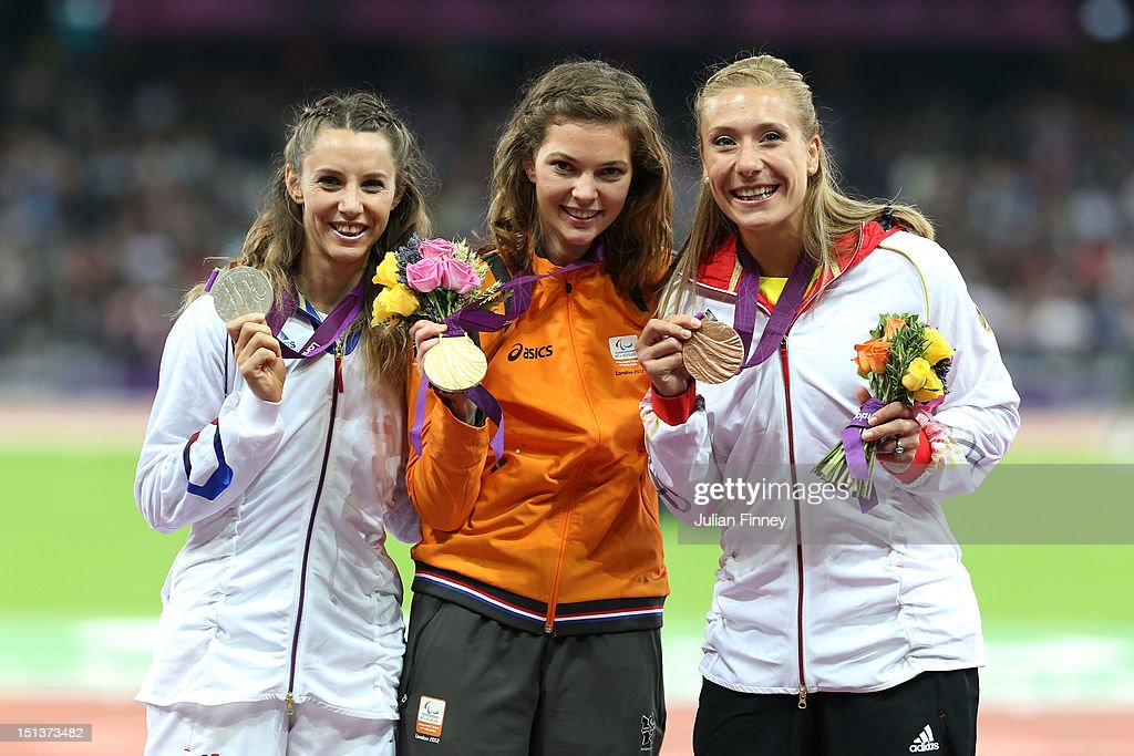 Silver medalist Marie-Amelie Le Fur of France, Gold medalist Marlou Van Rhijn of Netherlands and bronze medalist Katrin Green of Germany pose on the podium during the medal ceremony for the Women's 200m - T44 Final on day 8 of the London 2012 Paralympic Games at Olympic Stadium on September 6, 2012 in London, England.