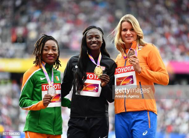 Silver medalist MarieJosee Ta Lou of Cote d'Ivoire gold medalist Tori Bowie of the United States and silver medalist Dafne Schippers of the...