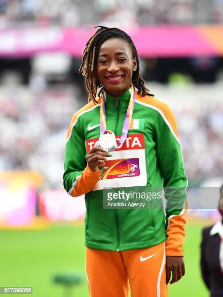 Silver medalist MarieJosee Ta Lou of Cote d'Ivoire poses with her medal for the competes in the Women's 100 metres during the 'IAAF Athletics World...