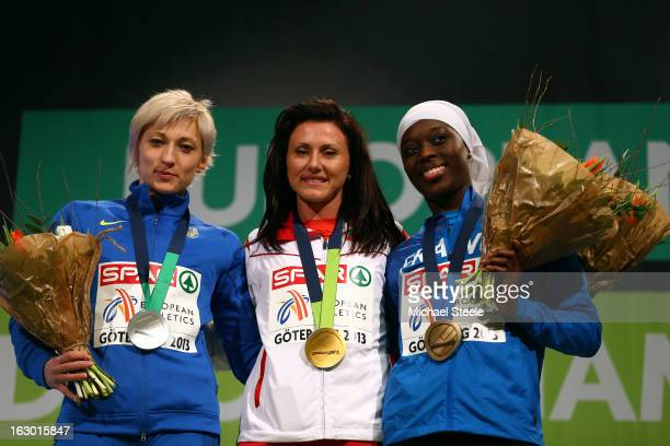 Silver medalist Mariya Ryemyen of Ukraine gold medalist Tezdzhan Naimova of Bulgaria and bronze medalist Myriam Soumare of France pose during the...