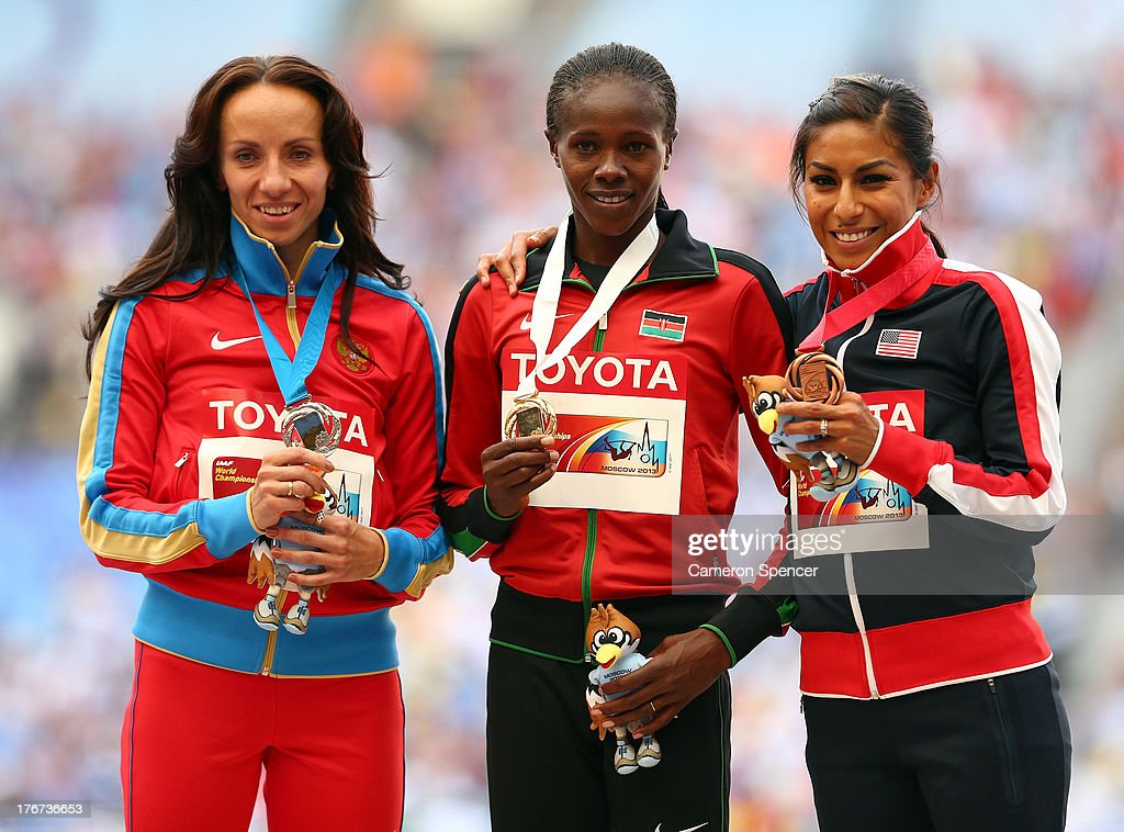 Silver medalist <a gi-track='captionPersonalityLinkClicked' href=/galleries/search?phrase=Mariya+Savinova&family=editorial&specificpeople=5747959 ng-click='$event.stopPropagation()'>Mariya Savinova</a> of Russia, gold medalist Eunice Jepkoech Sum of Kenya and bronze medalist Brenda Martinez of the United States stand on the podium during the medal ceremony for the Women's 800 metres during Day Nine of the 14th IAAF World Athletics Championships Moscow 2013 at Luzhniki Stadium on August 18, 2013 in Moscow, Russia.