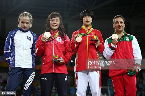 Silver medalist Mariya Stadnik of Azerbaijan gold medalist Eri Tosaka of Japan bronze medalist Yanan Sun of China and bronze medalist Elitsa...