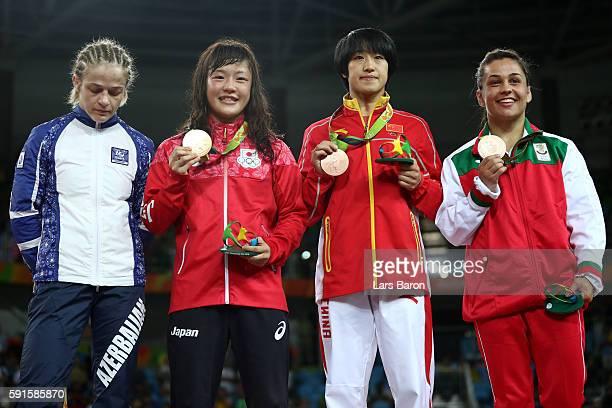 Silver medalist Mariya Stadnik of Azerbaijan gold medalist Eri Tosaka of Japan bronze medalist Yanan Sun of China and bronze medalist Elitsa...
