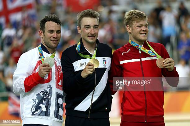 Silver medalist Mark Cavendish of Great Britain gold medalist Elia Viviani of Italy and bronze medalist Lasse Norman Hansen of Denmark pose on the...