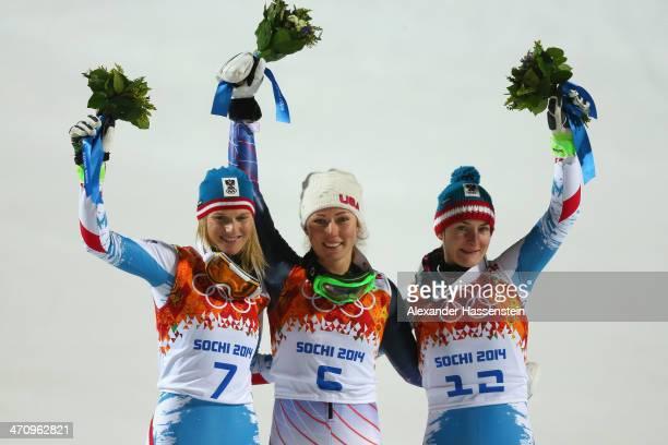 Silver medalist Marlies Schild of Austria gold medalist Mikaela Shiffrin of the United States and bronze medalist Kathrin Zettel of Austria celebrate...