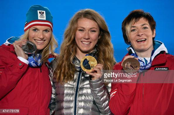 Silver medalist Marlies Schild of Austria gold medalist Mikaela Shiffrin of the United States and bronze medalist Kathrin Zettel of Austria celebrate...