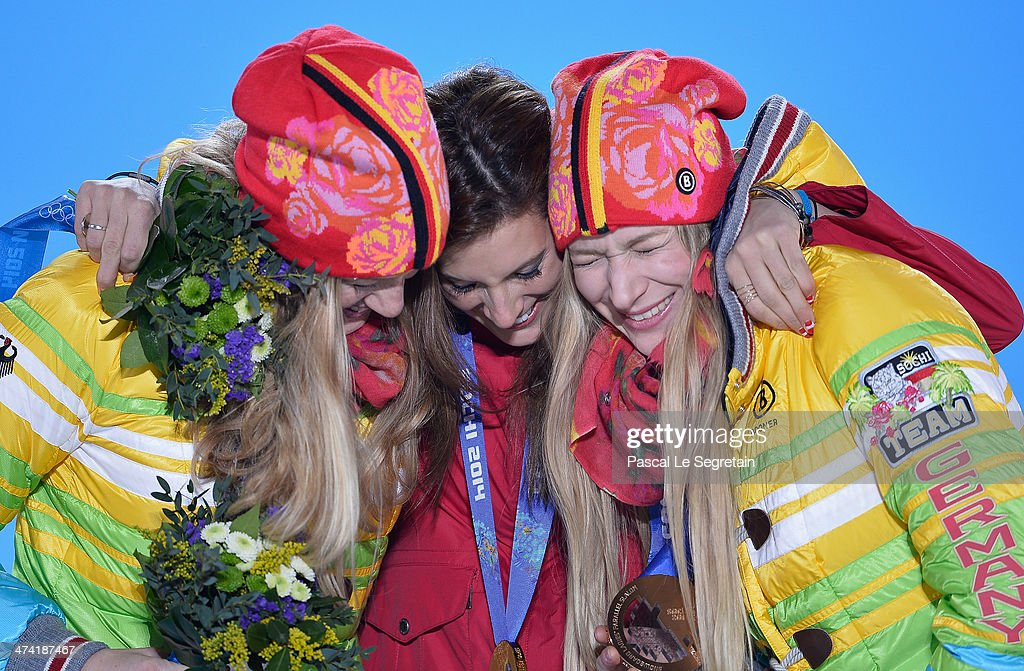 Silver medalist Marlies Schild of Austria, gold medalist Mikaela Shiffrin of the United States and bronze medalist Kathrin Zettel of Austria celebrate during the medal ceremony for the Women's Slalom on Day 15 of the Sochi 2014 Winter Olympics at Medals Plaza on February 22, 2014 in Sochi, Russia.
