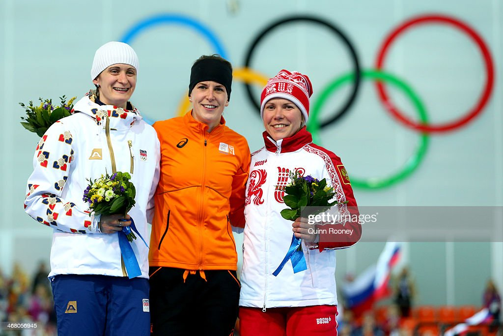 Silver medalist <a gi-track='captionPersonalityLinkClicked' href=/galleries/search?phrase=Martina+Sablikova&family=editorial&specificpeople=799963 ng-click='$event.stopPropagation()'>Martina Sablikova</a> of the Czech Republic, gold medalist Irene Wust of the Netherlands and bronze medalist <a gi-track='captionPersonalityLinkClicked' href=/galleries/search?phrase=Olga+Graf&family=editorial&specificpeople=8696814 ng-click='$event.stopPropagation()'>Olga Graf</a> of Russia celebrate on the podium during the flower ceremony for the Women's 3000m Speed Skating event during day 2 of the Sochi 2014 Winter Olympics at Adler Arena Skating Center on February 9, 2014 in Sochi, Russia.