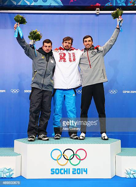 Silver medalist Martins Dukurs of Latvia gold medalist Alexander Tretiakov of Russia and bronze medalist Matthew Antoine of the United States pose on...