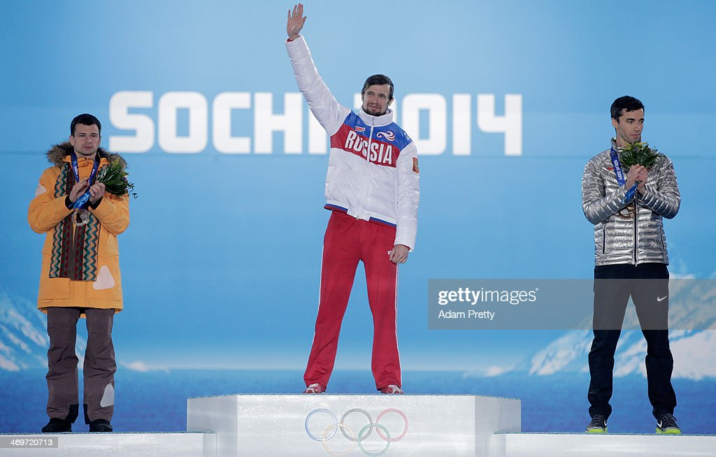Silver medalist <a gi-track='captionPersonalityLinkClicked' href=/galleries/search?phrase=Martins+Dukurs&family=editorial&specificpeople=4876286 ng-click='$event.stopPropagation()'>Martins Dukurs</a> of Latvia, gold medalist <a gi-track='captionPersonalityLinkClicked' href=/galleries/search?phrase=Alexander+Tretiakov&family=editorial&specificpeople=723551 ng-click='$event.stopPropagation()'>Alexander Tretiakov</a> of Russia and bronze medalist Matthew Antoine of United States celebrate on the podium during the medal ceremony for the Men's Skeleton on day 9 of the Sochi 2014 Winter Olympics at Medals Plaza on February 16, 2014 in Sochi, Russia.