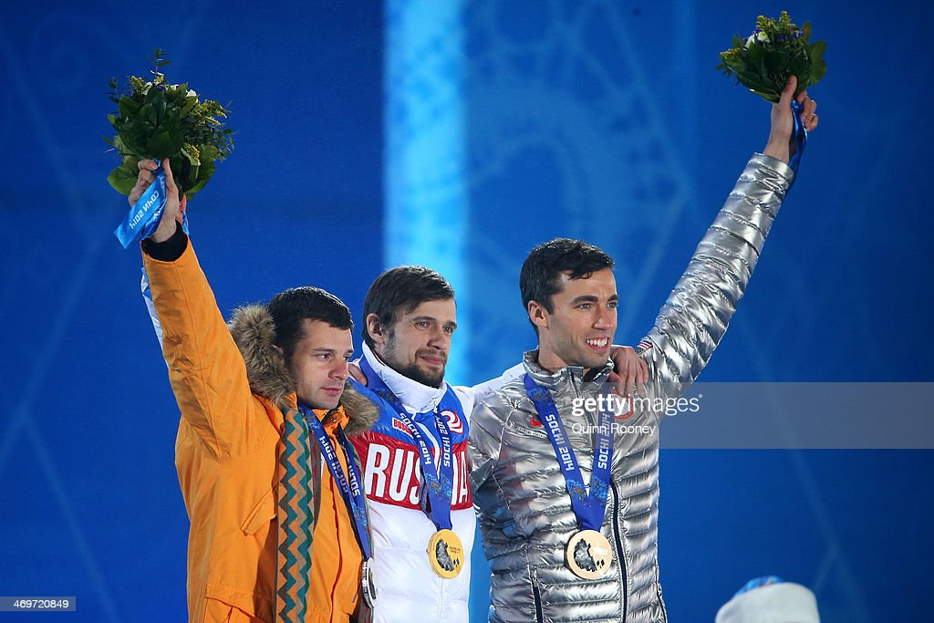 Silver medalist Martins Dukurs of Latvia, gold medalist Alexander Tretiakov of Russia and bronze medalist Matthew Antoine of United States celebrate on the podium during the medal ceremony for the Men's Skeleton on day 9 of the Sochi 2014 Winter Olympics at Medals Plaza on February 16, 2014 in Sochi, Russia.