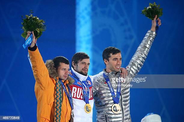 Silver medalist Martins Dukurs of Latvia gold medalist Alexander Tretiakov of Russia and bronze medalist Matthew Antoine of United States celebrate...