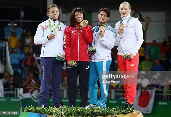 Silver medalist Maryia Mamashuk of Belarus gold medalist Risako Kawai of Japan bronze medalist Yekaterina Larionova of Kazakhstan and bronze medalist...