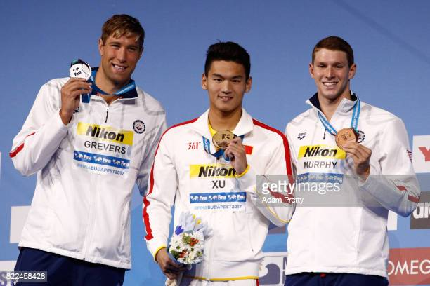 Silver medalist Matt Grevers of the United States gold medalist Jiayu Xu of China and bronze medalist Ryan Murphy of the United States pose with the...