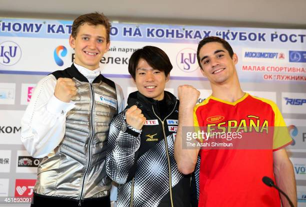 Silver medalist Maxim Kovtun of Russia gold medalist Tatsuki Machida of Japan and broze medalist Javier Fernandez of Spain pose for photographs after...