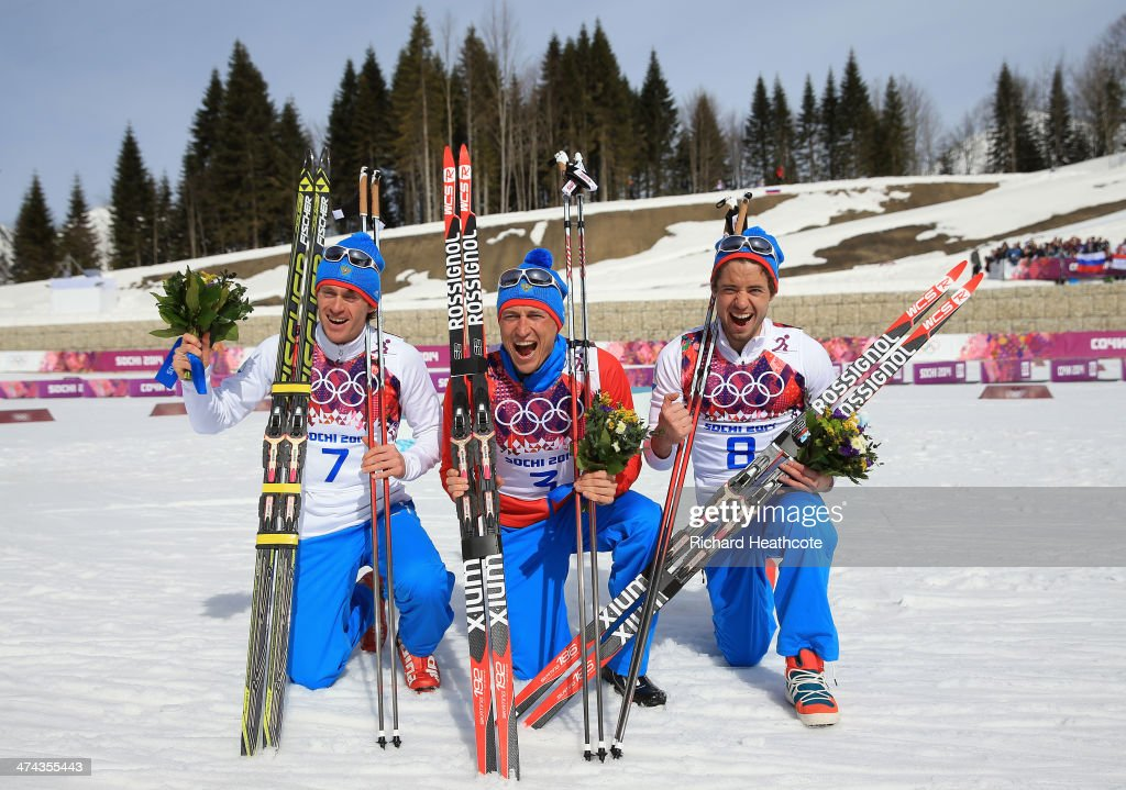 Silver medalist Maxim Vylegzhanin of Russia, gold medalist Alexander Legkov of Russia and bronze medalist Ilia Chernousov of Russia celebrate during the flower ceremony for the Men's 50 km Mass Start Free during day 16 of the Sochi 2014 Winter Olympics at Laura Cross-country Ski & Biathlon Center on February 23, 2014 in Sochi, Russia.