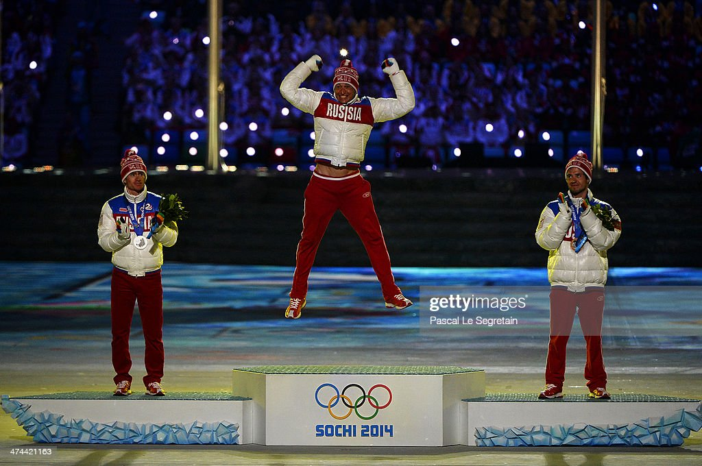 Silver medalist <a gi-track='captionPersonalityLinkClicked' href=/galleries/search?phrase=Maxim+Vylegzhanin&family=editorial&specificpeople=4779618 ng-click='$event.stopPropagation()'>Maxim Vylegzhanin</a> of Russia, gold medalist <a gi-track='captionPersonalityLinkClicked' href=/galleries/search?phrase=Alexander+Legkov&family=editorial&specificpeople=4037875 ng-click='$event.stopPropagation()'>Alexander Legkov</a> of Russia and bronze medalist <a gi-track='captionPersonalityLinkClicked' href=/galleries/search?phrase=Ilia+Chernousov&family=editorial&specificpeople=4137586 ng-click='$event.stopPropagation()'>Ilia Chernousov</a> of Russia celebrate during the medal ceremony for the Men's 50 km Mass Start Free during the 2014 Sochi Winter Olympics Closing Ceremony at Fisht Olympic Stadium on February 23, 2014 in Sochi, Russia.
