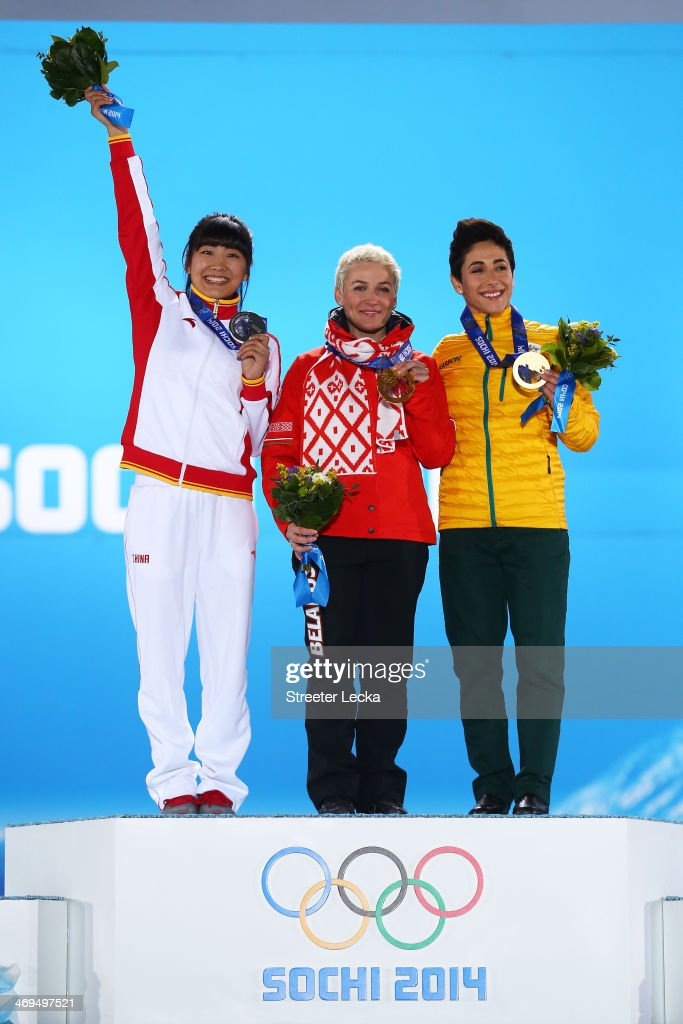 Silver medalist Mengtao Xu of China, gold medalist <a gi-track='captionPersonalityLinkClicked' href=/galleries/search?phrase=Alla+Tsuper&family=editorial&specificpeople=882784 ng-click='$event.stopPropagation()'>Alla Tsuper</a> of Beralus and bronze medalist <a gi-track='captionPersonalityLinkClicked' href=/galleries/search?phrase=Lydia+Lassila&family=editorial&specificpeople=4859096 ng-click='$event.stopPropagation()'>Lydia Lassila</a> of Australia celebrate on the podium during the medal ceremony for the Freestyle Skiing Ladies' Aerials on day 8 of the Sochi 2014 Winter Olympics at Medals Plaza on February 15, 2014 in Sochi, Russia.