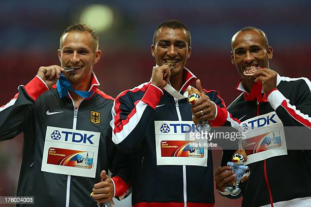 Silver medalist Michael Schrader of Germany gold medalist Ashton Eaton of United States and bronze medalist Damian Warner of Canada stand on the...