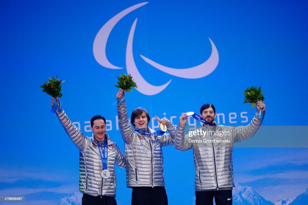 Silver medalist Michael Shea, gold medalist Evan Strong and bronze medalist Keith Gabel of the United States celebrate during the medal ceremony for Men's Snowboard Cross Standing on day seven of the Sochi 2014 Paralympic Winter Games on March 14, 2014 in Sochi, Russia.