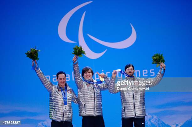 Silver medalist Michael Shea gold medalist Evan Strong and bronze medalist Keith Gabel of the United States celebrate during the medal ceremony for...