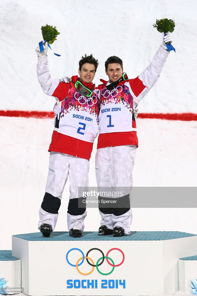 Silver medalist Mikael Kingsbury of Canada and gold medalist Alex Bilodeau of Canada celebrate on the podium during the flower ceremony for the Men's...