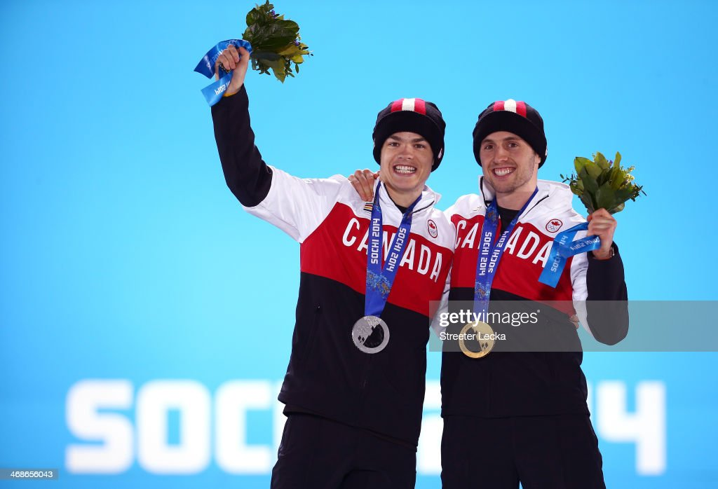 Silver medalist Mikael Kingsbury of Canada and gold medalist Alex Bilodeau of Canada celebrate on the podium during the medal ceremony for the for the Freestyle Skiing Men's Moguls on day 4 of the Sochi 2014 Winter Olympics at Medals Plaza on February 11, 2014 in Sochi, Russia.