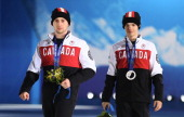 Silver medalist Mikael Kingsbury of Canada and gold medalist Alex Bilodeau of Canada celebrate on the podium during the medal ceremony for the for...