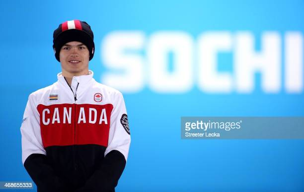 Silver medalist Mikael Kingsbury of Canada celebrates during the medal ceremony for the Freestyle Skiing Men's Moguls on day 4 of the Sochi 2014...
