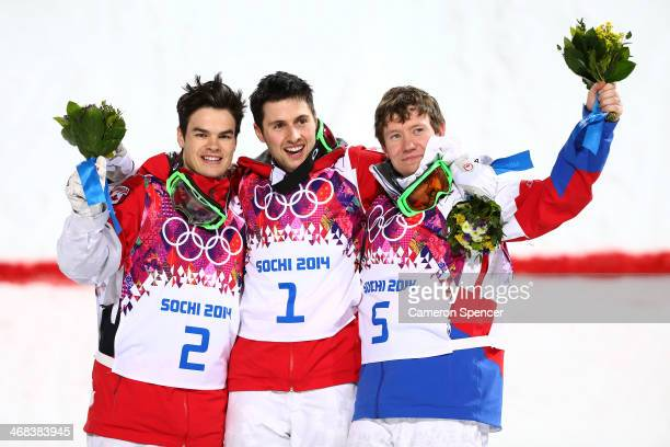 Silver medalist Mikael Kingsbury of Canada gold medalist Alex Bilodeau of Canada and Alexandr Smyshlyaev of Russia celebrate on the podium during the...