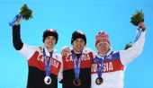 Silver medalist Mikael Kingsbury of Canada gold medalist Alex Bilodeau of Canada and bronze medalist Alexandr Smyshlyaev of Russia celebrate on the...