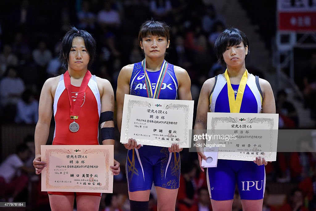 Silver medalist Mikako Higuchi and Gold Medalist <a gi-track='captionPersonalityLinkClicked' href=/galleries/search?phrase=Kaori+Icho&family=editorial&specificpeople=2374687 ng-click='$event.stopPropagation()'>Kaori Icho</a> and Bronz medalist Nachi Masuda pose for photographs on the podium at the award ceremony of the Women's 58kg free style during All Japan Wrestling Championships at Yoyogi National Gymnasium on June 21, 2015 in Tokyo, Japan.