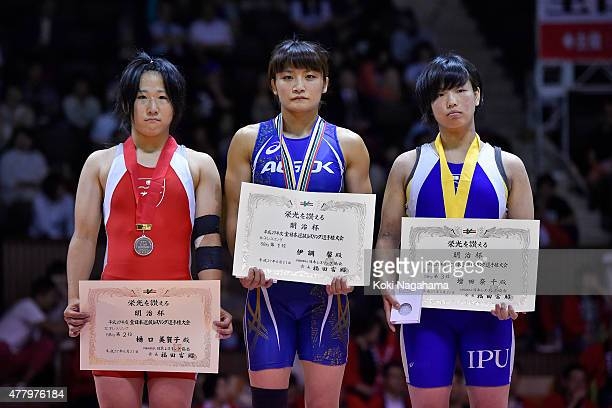 Silver medalist Mikako Higuchi and Gold Medalist Kaori Icho and Bronz medalist Nachi Masuda pose for photographs on the podium at the award ceremony...