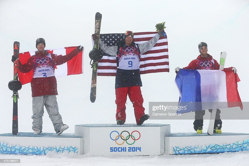 Silver medalist <a gi-track='captionPersonalityLinkClicked' href=/galleries/search?phrase=Mike+Riddle&family=editorial&specificpeople=3394304 ng-click='$event.stopPropagation()'>Mike Riddle</a> of Canada, gold medalist David Wise of the United States and bronze medalist <a gi-track='captionPersonalityLinkClicked' href=/galleries/search?phrase=Kevin+Rolland&family=editorial&specificpeople=4840688 ng-click='$event.stopPropagation()'>Kevin Rolland</a> of France celebrate during the flower ceremony for the Freestyle Skiing Men's Ski Halfpipe Finals on day eleven of the 2014 2014 Winter Olympics at Rosa Khutor Extreme Park on February 18, 2014 in Sochi, Russia.