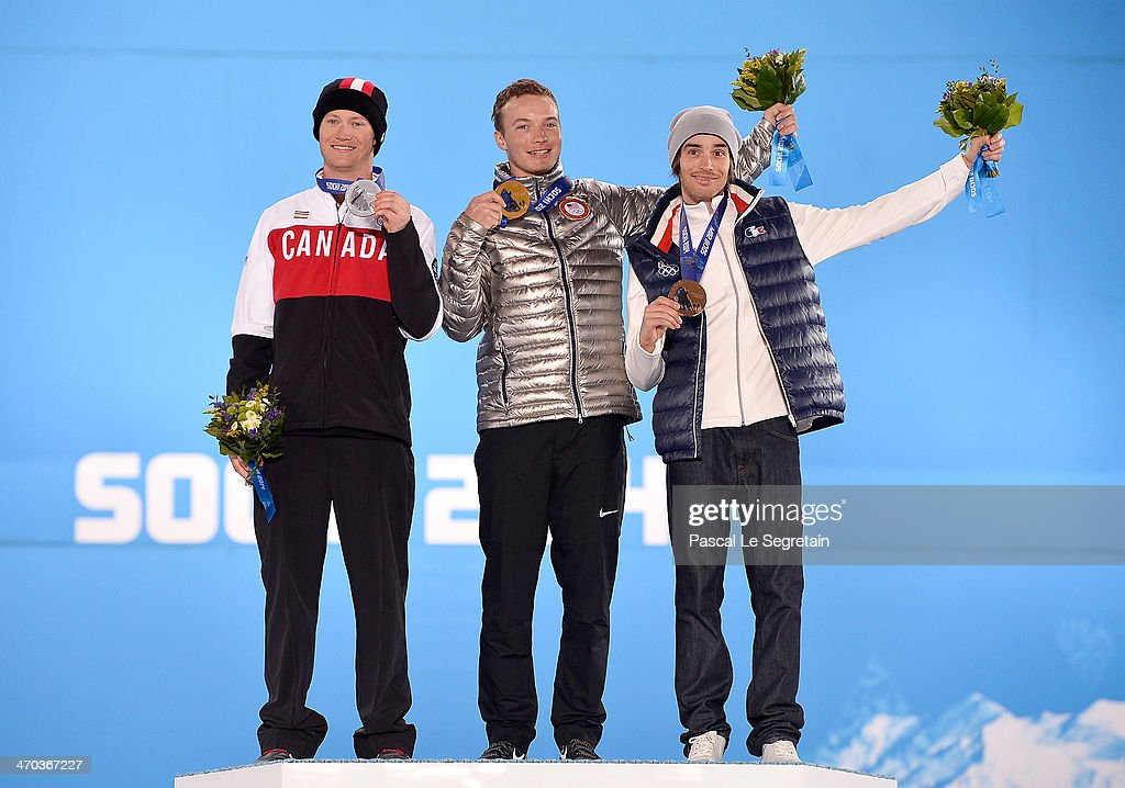 Silver medalist <a gi-track='captionPersonalityLinkClicked' href=/galleries/search?phrase=Mike+Riddle&family=editorial&specificpeople=3394304 ng-click='$event.stopPropagation()'>Mike Riddle</a> of Canada, gold medalist David Wise of the United States and bronze medalist <a gi-track='captionPersonalityLinkClicked' href=/galleries/search?phrase=Kevin+Rolland&family=editorial&specificpeople=4840688 ng-click='$event.stopPropagation()'>Kevin Rolland</a> of France celebrate on the podium during the medal ceremony for the Men's Ski Halfpipe on day twelve of the Sochi 2014 Winter Olympics at at Medals Plaza on February 19, 2014 in Sochi, Russia.