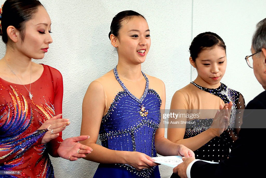 Silver medalist Miki Ando, gold medalist Yuki Nishino and bronze medalist Mayu Yamamoto are seen during the East Japan Figure Skating Championships at Gunma Prefecture Sports Center Ice Arena on November 4, 2013 in Maebashi, Gunma, Japan.